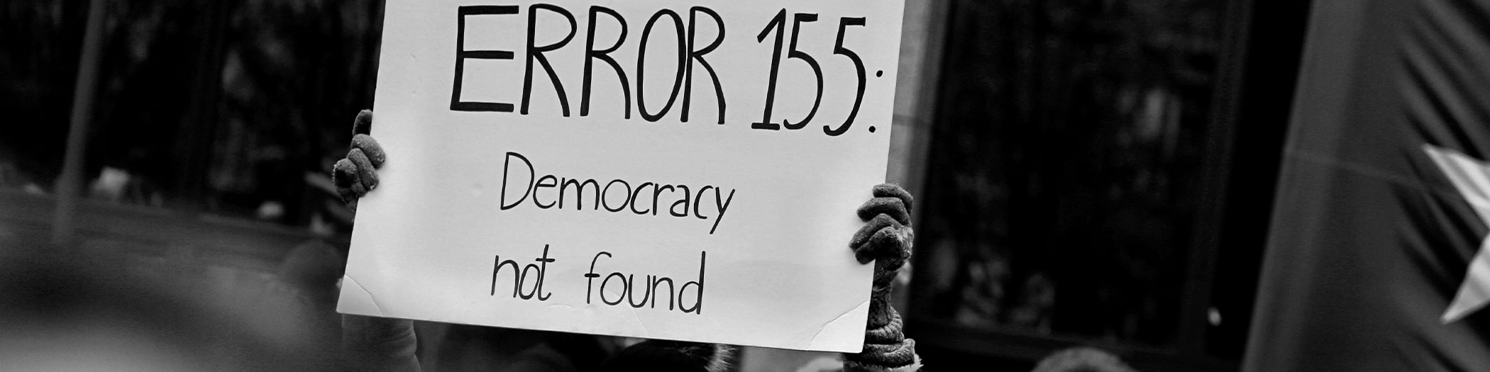 Sign saying error 155: democracy not found