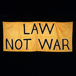 Sign saying law not war