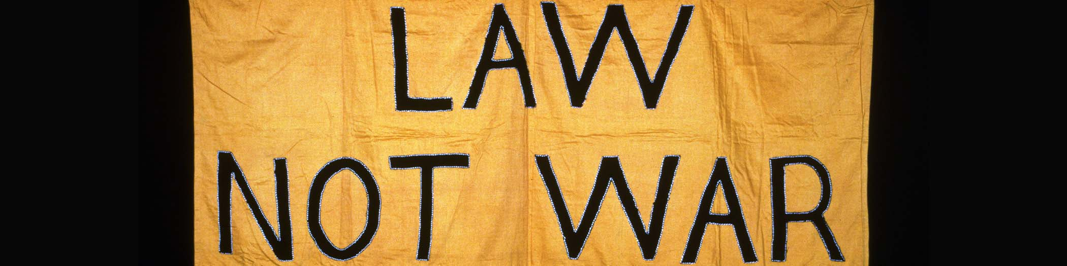 Sign saying 'Law not war'