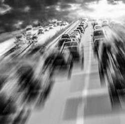 black and white blurred cars driving