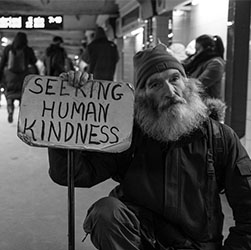small homeless man with sign